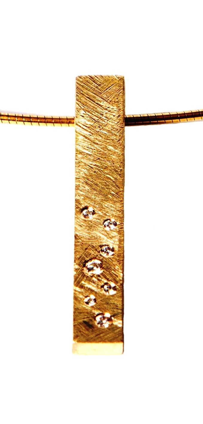 Guldvedhæng 14 kt. Brillanter to stk. o,o2 ct. og fem stk 0.01 ct. tw. vvs Pris 8500,- kr. Des. nr. 116